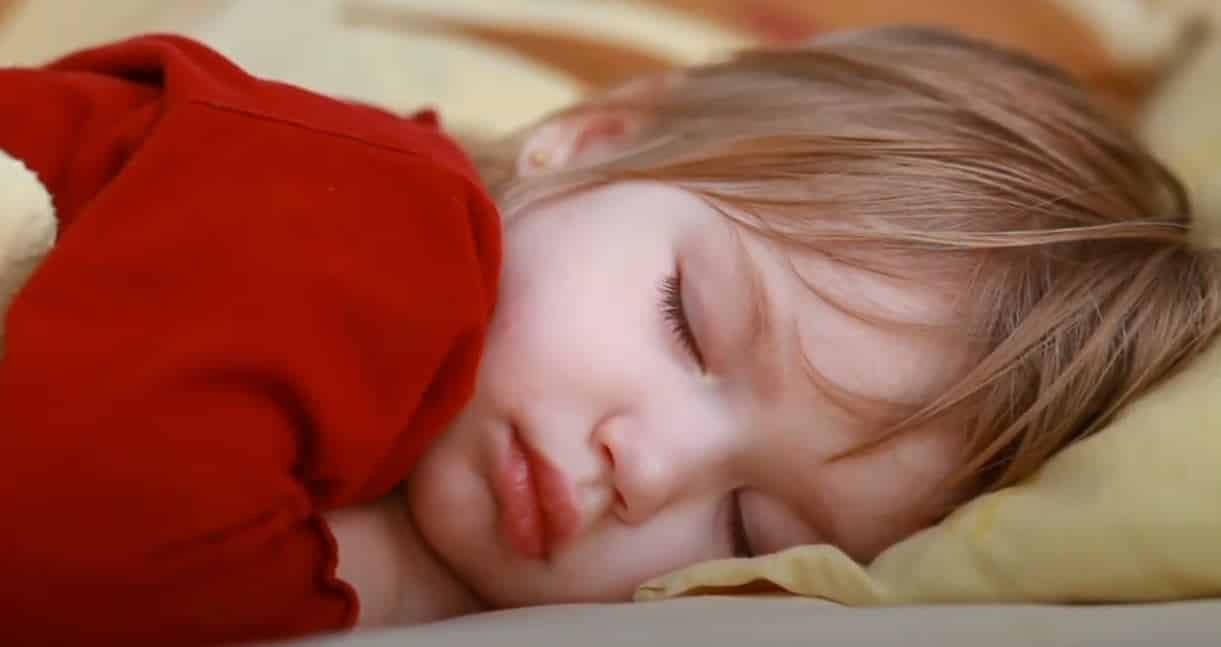 when can babies sleep with blankets
